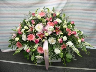 Pink And Peaceful Casket Arrangement
