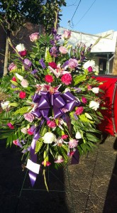 Pink and purple spray Funeral  in Mount Vernon, TX | GLAMMIEZ BOUTIQUE & FLORAL