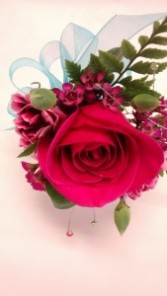 pink and sparkles corsage prom