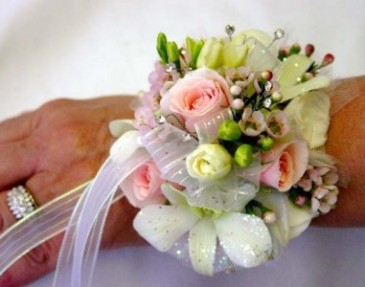 Pink and white corsage Orchids and roses