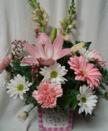 Pink and White flowers in ceramic cube. Flowers  may vary depending on the season.