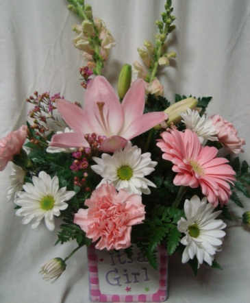 Pink And White Flowers In Ceramic Cube Flowers May Vary Depending