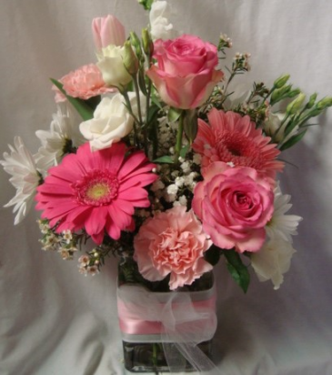 Pink and White flowers in cute ribbon decorated  cube vase.