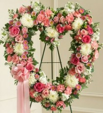 pink and white standing open heart roses,chrysalis,carnations, spider mums, white stock, aster, monte