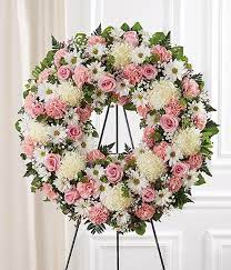 PINK AND WHITE WREATH FUNERAL PIECE WAS $225.00/NOW 175.00
