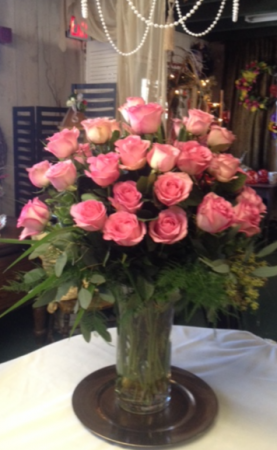 PInk Elegance, vase of roses Vase of pink roses adorned with mixed foliage