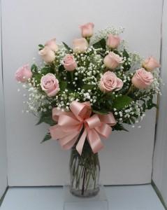 Pink long stem roses Arranged in glass vase