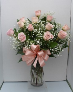 Pink long stem roses Arranged in glass vase
