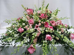 Pink oasis Casket spray in Bryson City, NC | Village Florist & Christian Book Store