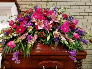 Pink and Purple Remembrance Casket Spray in Henderson, TX | RAYFORD FLORIST & GIFTS