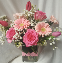 """SHADES OF PINKS""Seasonal pink flowers in a DAISY  ribbon detailed rectangular  vase."