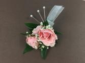 Pink rose boutonnière
