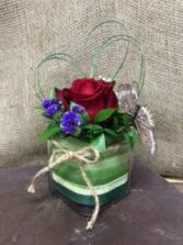 Simple gesture Rose in mini cube vase