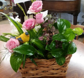 Plant basket with a bird