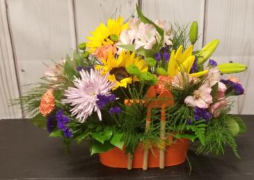 Planter with Tools Floral Arrangement