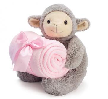 Plush lamb with pink blanket