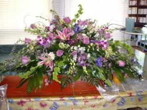 Plush purples and pink Garden Casket Spray in Saint Louis, MO | OFF THE WALL FLORIST & GIFTS