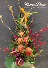 Polly Tropical Wildflower Arrangement in Ceramic Container