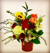 Pottery & Floral Arrangement Elegant Floral Designed in a Pottery Vase