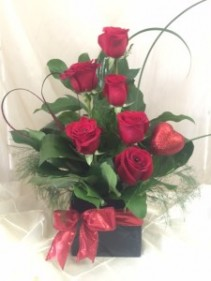 Fancy and Funky Valentine Roses Half dozen red roses with greens