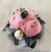Pink ranuculus corsage