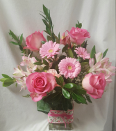 """PRETTY IN PINK"" ALL FLOWERS ARE PINK. SOME  flowers may vary depending on stock. ARRANGED in a cute ribbon rectangular vase!"