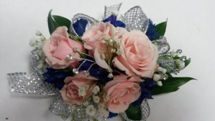 Pretty in pink blue wrist corsage in le sueur mn le sueur florist pretty in pink blue wrist corsage mightylinksfo