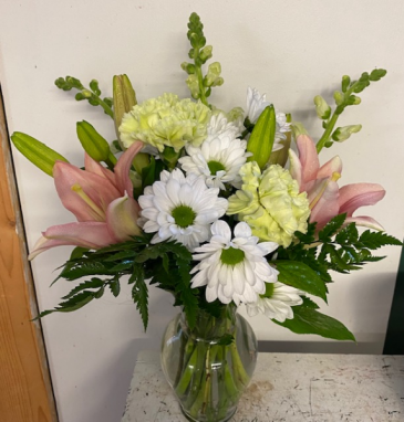 Pretty in pink Fresh arrangement with daisies, lilies, and carnations!