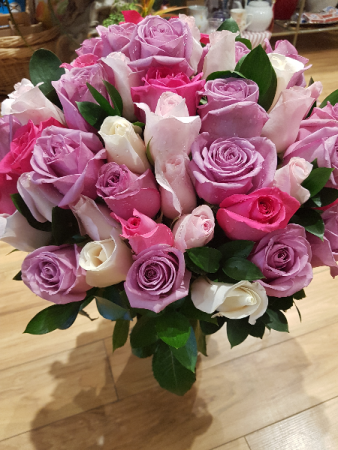 PURPLE MAGICAL RAINBOW 5 dozen Roses arranged in vase