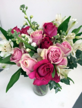 Pretty in Pinks Pink roses, peruvian lilies and seasonal greens