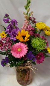 PRETTY PLEASE Bouquet...seasonal bright flowers In a mason jar. Mason Jar  colors may vary.