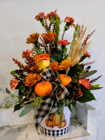 Pumpkins, berries and flowers Fresh flower arrangement