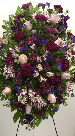 purple carnations and lavender roses standing spray