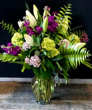 Purple, Green with white lilies Vase arrangement in Key West, FL | Petals & Vines