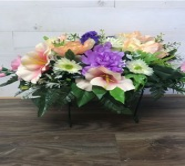 Purple, pink & yellow headstone saddle  Silk flowers
