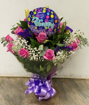 Purple roses in a vase Birthday