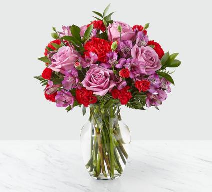 Purple surprise  Fresh arrangement in a vase