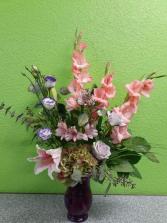 Purple vase arrangement