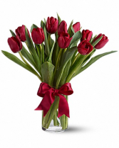 radiantly red tulips  vase