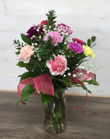Rainbow of color carnations Fresh cut arrangement
