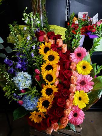 rainbow of roses in basket