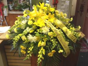 Ray of light Yellow Casket Spray in Saint Louis, MO | OFF THE WALL FLORIST & GIFTS