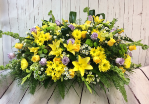 Ray of Sunshine Casket Spray  in Culpeper, VA | ENDLESS CREATIONS FLOWERS AND GIFTS