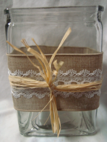 RECTANGULAR VASE WITH BURLAP AND RAFFIA ribbon detail. Just select a price and we will fill with a bright mixture of spring flowers!