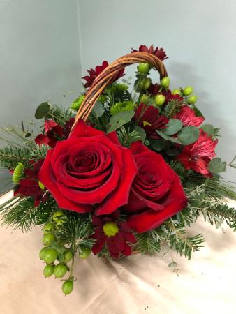 Red and Green evergreen basket arrangement