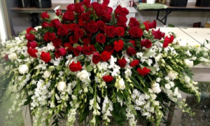 Red and White Casket Spray  in Bronx, NY | Bella's Flower Shop