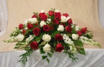 RED AND WHITE ROSES, SNAPDRAGONS CASKET SPRAY