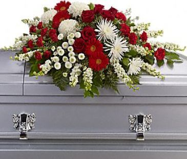 red and white tribute funeral casket spray