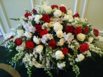 RED AND WHITE TRIBUTE Half Couch of red and white roses, white snapdragons, carnations , larkspur and more.