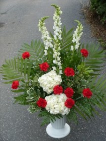 Red and White Urn Shown at $65.00